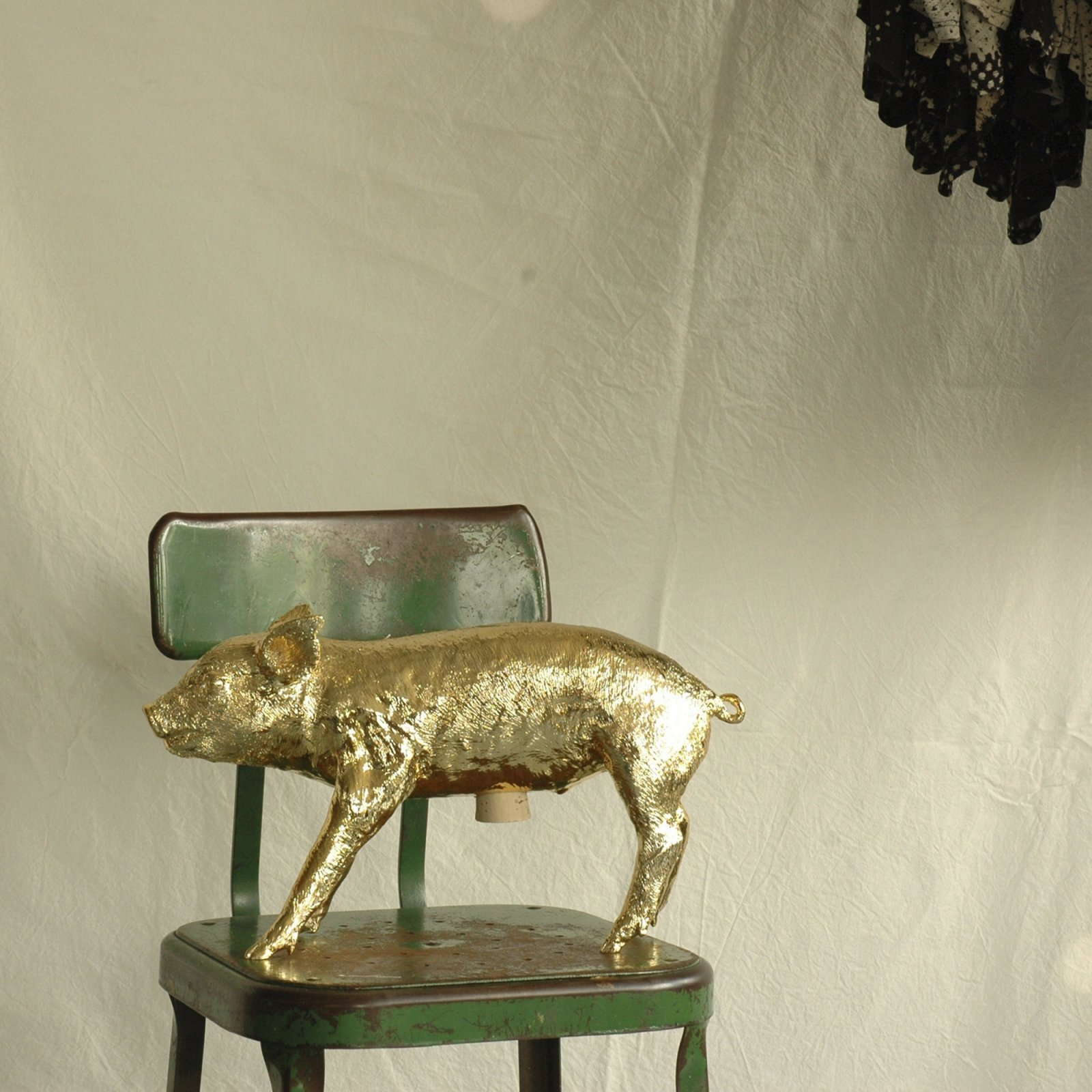 reality-bank-in-the-form-of-a-pig-gold-chrome-3